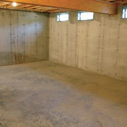 A cleaned out basement in Kenosha, shown before remodeling has begun