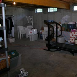 An unfinished basement filled with clutter in Rockford, IL.