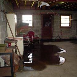 A flooded basement showing groundwater intrusion in Milwaukee