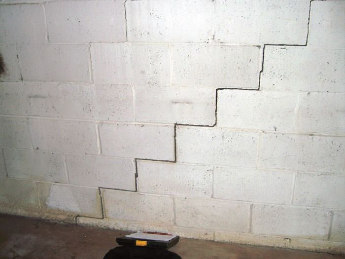 A Diagonal Stair Step Along The Foundation Wall Of Watertown Home