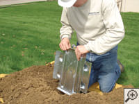 Steel earth anchor assembly installation in Menomonee Falls.