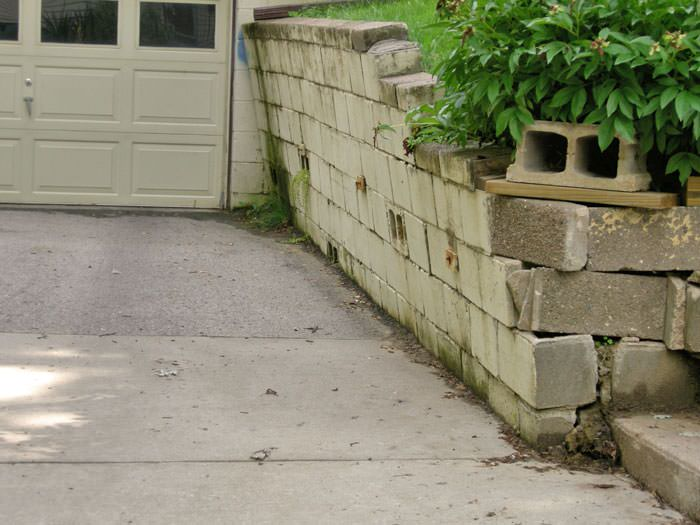 a failing retaining wall around a driveway in Milwaukee