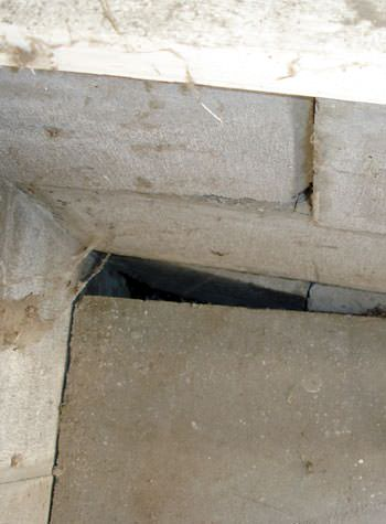 inward rotation of a foundation wall damaged by street creep in a garage in Fort Atkins