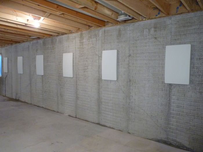 hide a way foundation wall anchor covers in milwaukee madison rh badgerbasementsystems com covering basement walls with cement covering cinder block basement walls