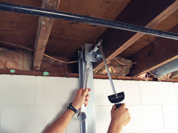 straightening a foundation wall with the powerbrace i beam system