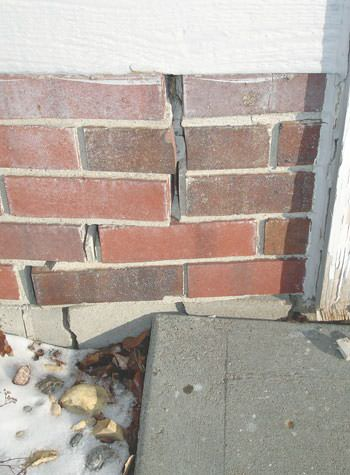 severe street creep damage to a garage wall outside a richland center