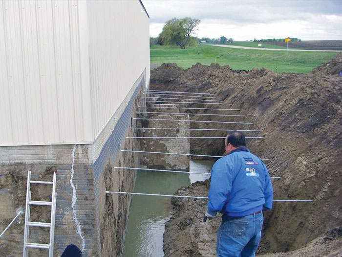 repairing straightening tilting foundation walls by authorized rh badgerbasementsystems com