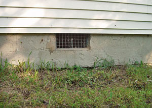 Open crawl space vents that let rodents, termites, and other pests in a home in Menomonee Falls