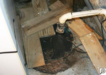 An ugly, clogged sump pump system in Kenosha, Wisconsin & Illinois
