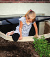 A child crawling out of an egress entryway window system in Eau Claire.