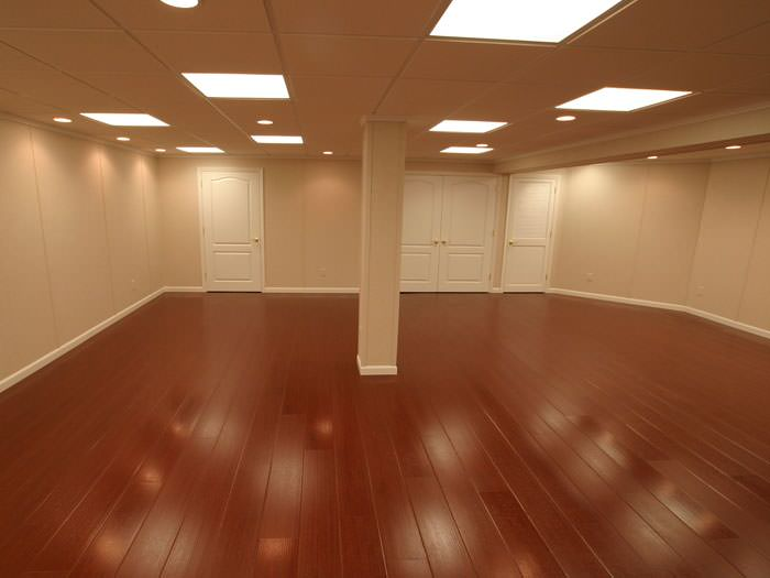 Wood laminate basement floor finishing warrantied for Simulated wood flooring